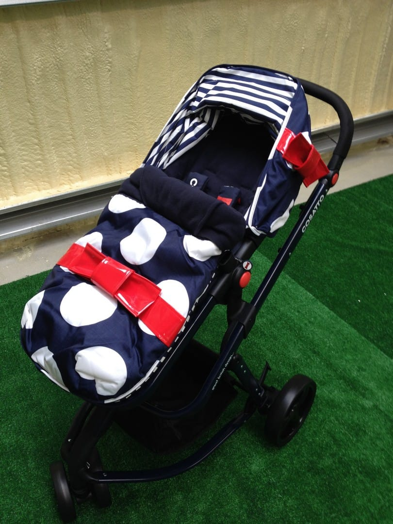 The Cosatto Giggle 2 with footmuff