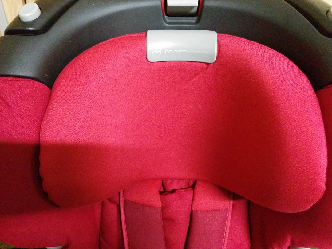 Headrest with button to adjust