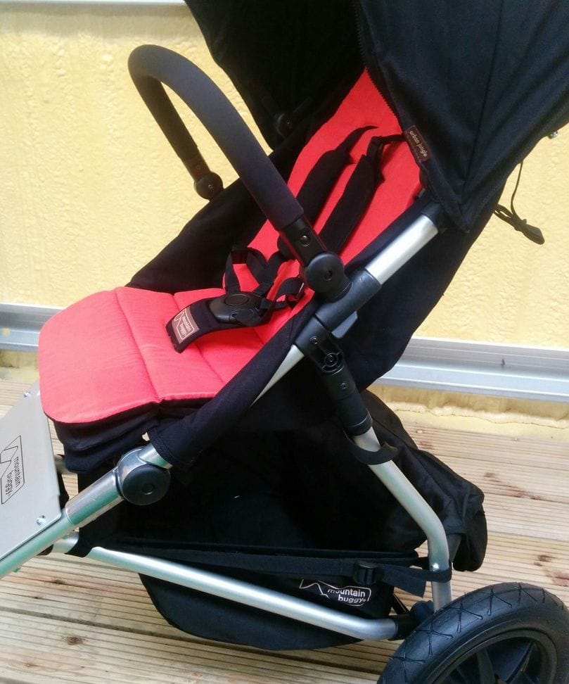 The Mountain Buggy Urban Jungle with coral reversible liner
