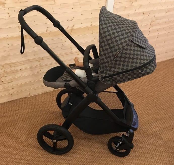 The Mountain Buggy Cosmopolitan Luxury Pushchair parent facing