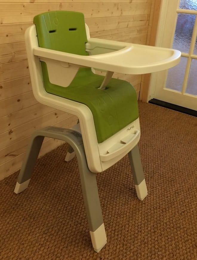 Nuna Zaaz Highchair with removable food tray, leg rest and safety bar